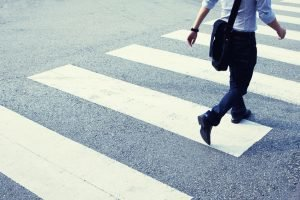 Student or modern office worker at a zebra crossing.