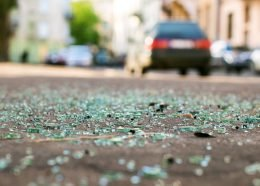 Shards of car glass on the street. Via iStock