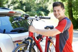 Cycling loading his bike onto a car