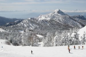 snowy mountains and skiers in Japan
