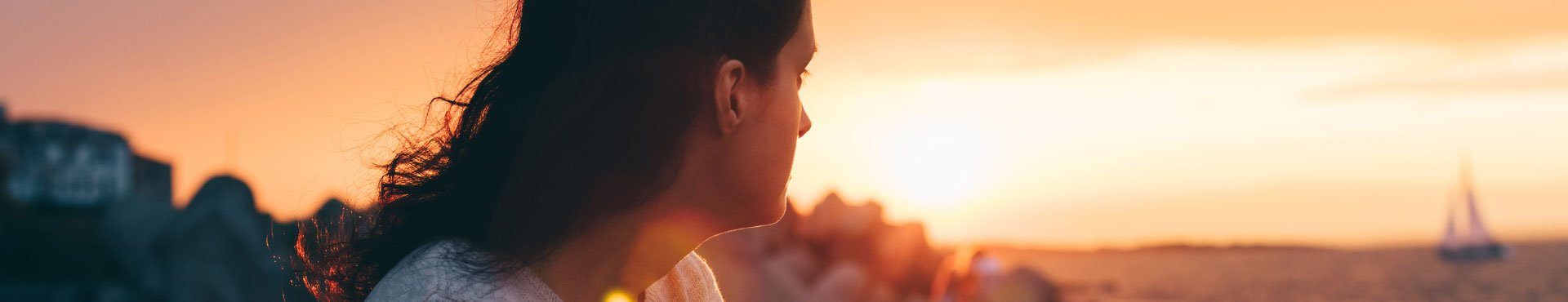 Female looking at a sunset | Shine Lawyers