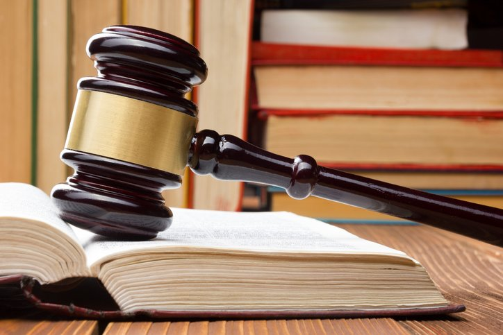 Law book with wooden gavel | Shine Lawyers