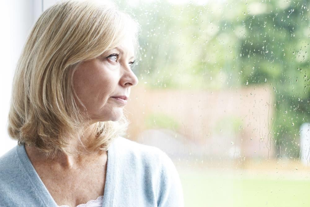 sad-woman-staring-out-window-thumb