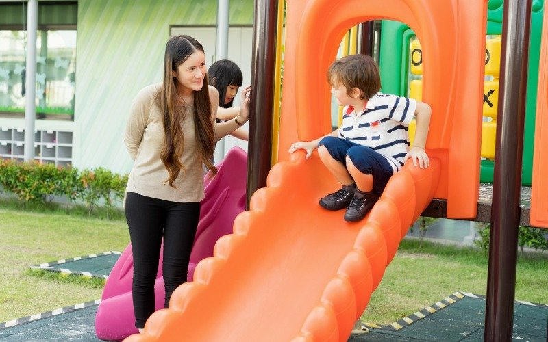 Teacher and Child in a playground | Shine Lawyers