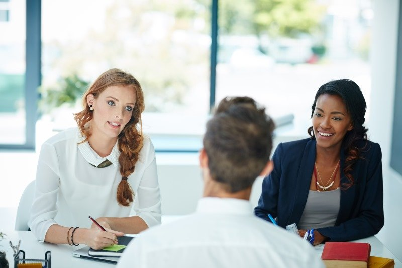 Two business women interview potential employee   Shine Lawyers