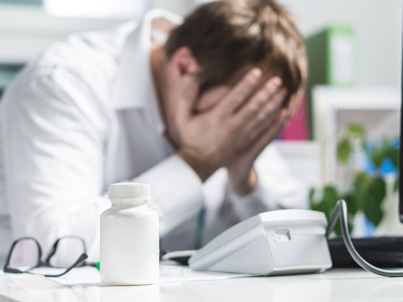 Stressed out doctor in the office | Shine Lawyers