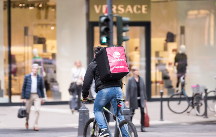 Foodora rider delivering food | Shine Lawyers