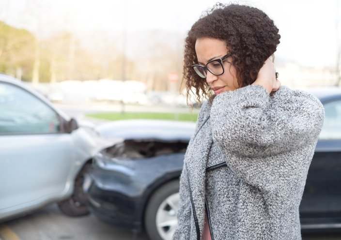 Woman at the scene of a crash   Shine Lawyers