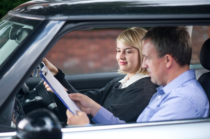 Woman taking a driving test   Shine Lawyers